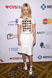 Alice Eve added a quirky touch with a pair of eye, nose, and lip-embellished pumps.
