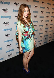 Holland Roden wore a flirty chiffon dress paired with a pearl cocktail ring and bright blue pumps.