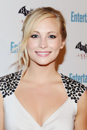 Candice Accola wore her hair in a classic bun with draped bangs when she attended the Entertainment Weekly Comic-Con celebration.