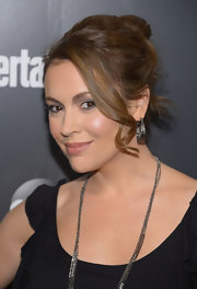 Alyssa Milano arrived at the ABC Upfront VIP party wearing her chestnut locks in a loose bun with a few long curls.