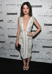 Lucy Hale complemented her dress with a pair of silver evening sandals.