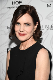 Elizabeth McGovern attended the Entertainment Weekly SAG nominees celebration wearing a short cut with curly ends.