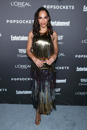 Amanda Brugel matched her dress with gold platforms by Stuart Weitzman.