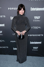 Sophia Bush paired her dress with a circular silver clutch.