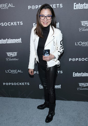 Black moto boots completed Michelle Yeoh's ensemble.