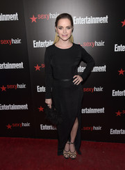Taryn Manning finished off her outfit with a black feather clutch by Milly.