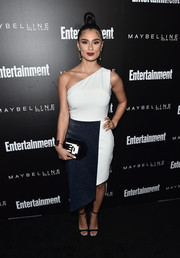 Diane Guerrero went ultra modern in a Karigam two-tone one-shoulder dress with an asymmetrical hem at the Entertainment Weekly celebration honoring the SAG nominees.