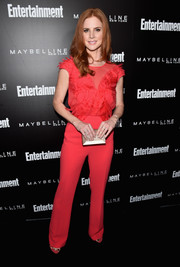 Sarah Rafferty brightened up the Entertainment Weekly celebration honoring the SAG nominees with this red Elisabetta Franchi jumpsuit.