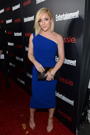 Jane Krakowski completed her elegant look with a pair of evening sandals featuring clear vamps and gold ankle straps.