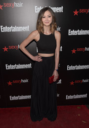 Kimiko Glenn added a feminine touch with a pleated black maxi skirt.