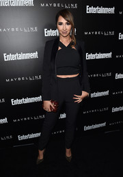 For a splash of color, Jackie Cruz accessorized with an embellished red box clutch.