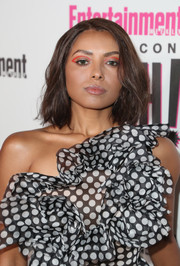 Kat Graham swiped on some red eye makeup for a modern and funky beauty look.