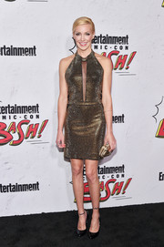 Katie Cassidy glammed it up in a gold halter dress with a peekaboo front at the Entertainment Weekly Comic-Con party.