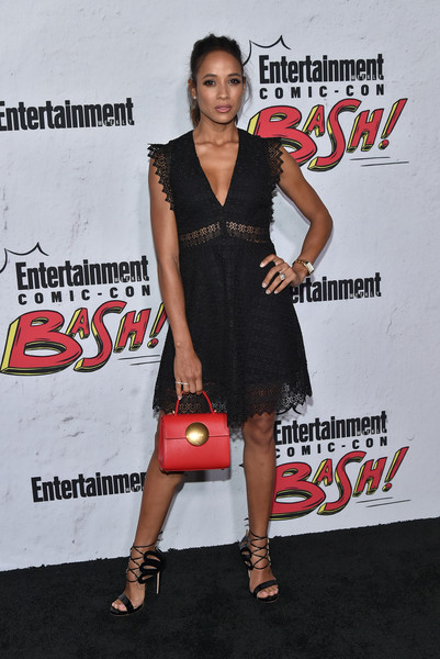 For a pop of color to her black look, Dania Ramirez accessorized with a red leather purse.
