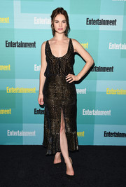 Lily James went for sexy sophistication in a low-cut, high-slit Altuzarra dress, featuring bronze beading on sheer black fabric, during the Entertainment Weekly Comic-Con party.
