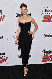 Angela Sarafyan was flirty-chic in a strapless black Rasario jumpsuit with a ruffled sweetheart neckline at the Entertainment Weekly Comic-Con party.