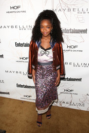 Marsai Martin toughened up her dress with a copper-hued bomber jacket.