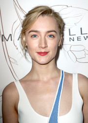 Saoirse Ronan attended Entertainment Weekly's SAG Awards nominees celebration wearing her hair in a messy updo.