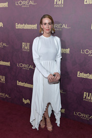 A Jimmy Choo studded perspex clutch with a mauve pouch finished off Sarah Paulson's ensemble.