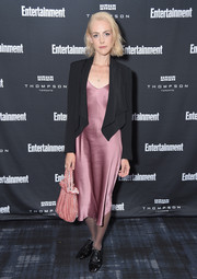 For her arm candy, Jena Malone chose a cute blush velvet bag.
