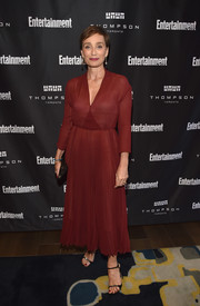 Kristin Scott Thomas styled her dress with a pair of embellished slim-strap heels, also by Dior.