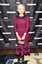 Helen Mirren looked perfectly polished in a burgundy Dolce & Gabbana midi dress with black embroidery at the Entertainment Weekly Must-List party.