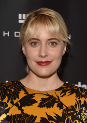 Greta Gerwig was casually coiffed with this ponytail with wispy bangs at the Entertainment Weekly Must-List party.