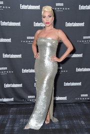 Lady Gaga kept the shine going with a pair of silver multi-strap heels.
