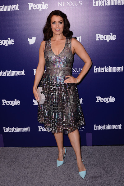 Bellamy Young teamed her frock with a pair of pastel-blue pumps.