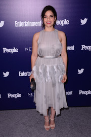 America Ferrera sported a girly silhouette in this ruffled gray cocktail dress during the Entertainment Weekly and People celebration of the New York Upfronts.