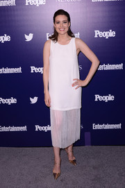 Megan Boone was '20s-chic in a sleeveless white shift dress with a pleated, sheer skirt at the Entertainment Weekly and People celebration of the New York Upfronts.