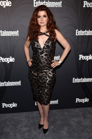 Debra Messing showed off her figure in a form-fitting metallic dress with a strappy V neckline at the Entertainment Weekly and People New York Upfronts.