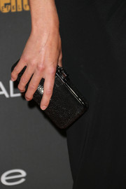 Yvonne Strahovski accessorized with a textured black hard-case clutch when she attended the Entertainment Weekly pre-Emmy party.