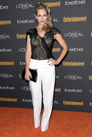 Meredith Monroe paired a deconstructed-chic black lace blouse with white slacks for the Entertainment Weekly pre-Emmy party.