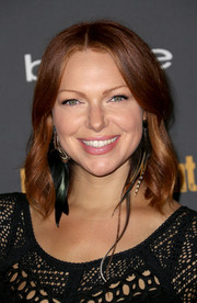 Laura Prepon was hippie-chic at the Entertainment Weekly pre-Emmy party with this center-parted wavy 'do.