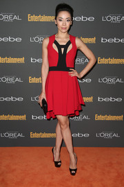 Aimee Garcia showed her modern style in a red and black cocktail dress with a peekaboo neckline during the Entertainment Weekly pre-Emmy party.