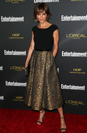 Lisa Rinna showed off her fit physique in a tight black top with cap sleeves at the Entertainment Weekly pre-Emmy party.
