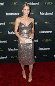 Jennifer Morrison complemented her sparkly frock with an elegant pearlized box clutch by Edie Parker.