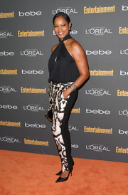 Garcelle Beauvais looked smart and sexy in animal-print pants and a halter top at the Entertainment Weekly pre-Emmy party.