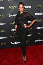 Essence Atkins teamed her blouse with a pair of high-waisted black slacks.