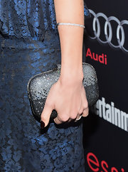 Julie Benz added a dash of sparkle to her look with a rhinestone-covered minaudiere.