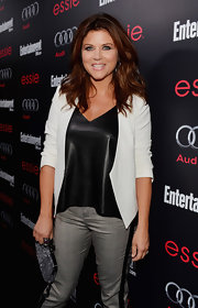 Tiffani Thiessen went for a chic neutral look with this white blazer and black leather top combo at the pre-SAG party.