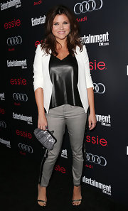 Tiffani Thiessen teamed gray skinny pants with a leather top and a white jacket for an ultra-chic finish at the Screen Actors Guild Awards pre-party.