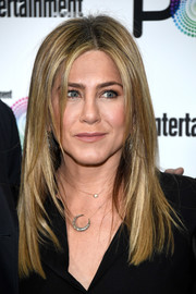Jennifer Aniston accessorized with a cute moon pendant.