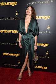 Alyssa Miller amped up the sultriness with a pair of barely-there black sandals.