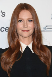 Darby Stanchfield wore a flawlessly styled center-parted wavy 'do at the EMA Awards.