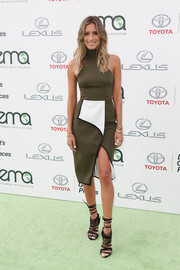 Renee Bargh went the ultra-modern route at the EMA Awards in a sleeveless army-green turtleneck dress with an asymmetrical wrap skirt.