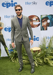 Chris O'Dowd looked sleek and stylish as ever in this dark gray notch-lapel suit, which he paired over a patterned polo.
