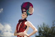Supermodel Erin O'Connor attended The Derby Festival in Epsom wearing a blue, fuchsia, purple, and pink custom-made headpiece by Louis Mariette.