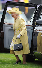 The Queen matched her yellow sun hat to her bright embroidered coat for the royal wedding.